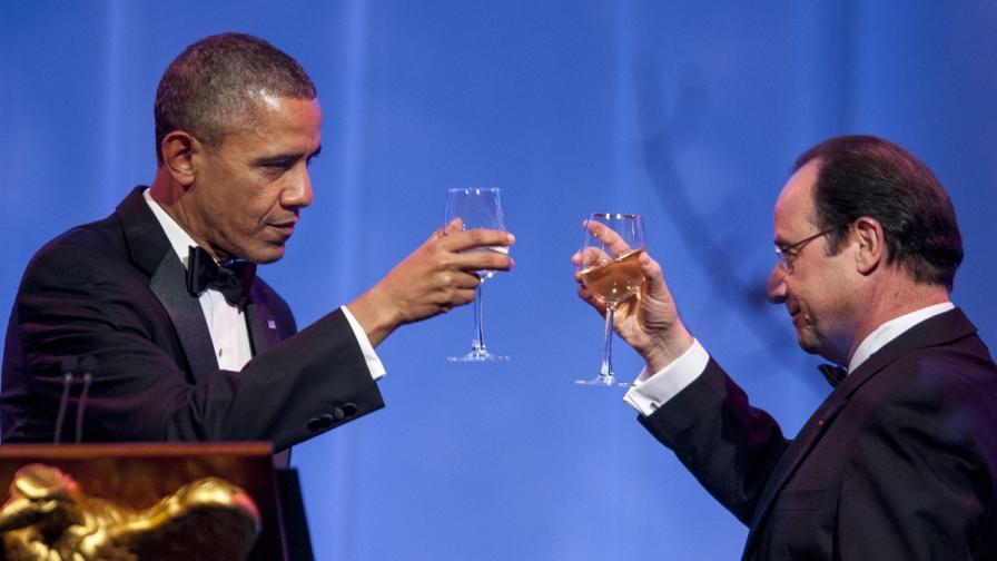 Барак Обама (л) и Франсоа Оланд
