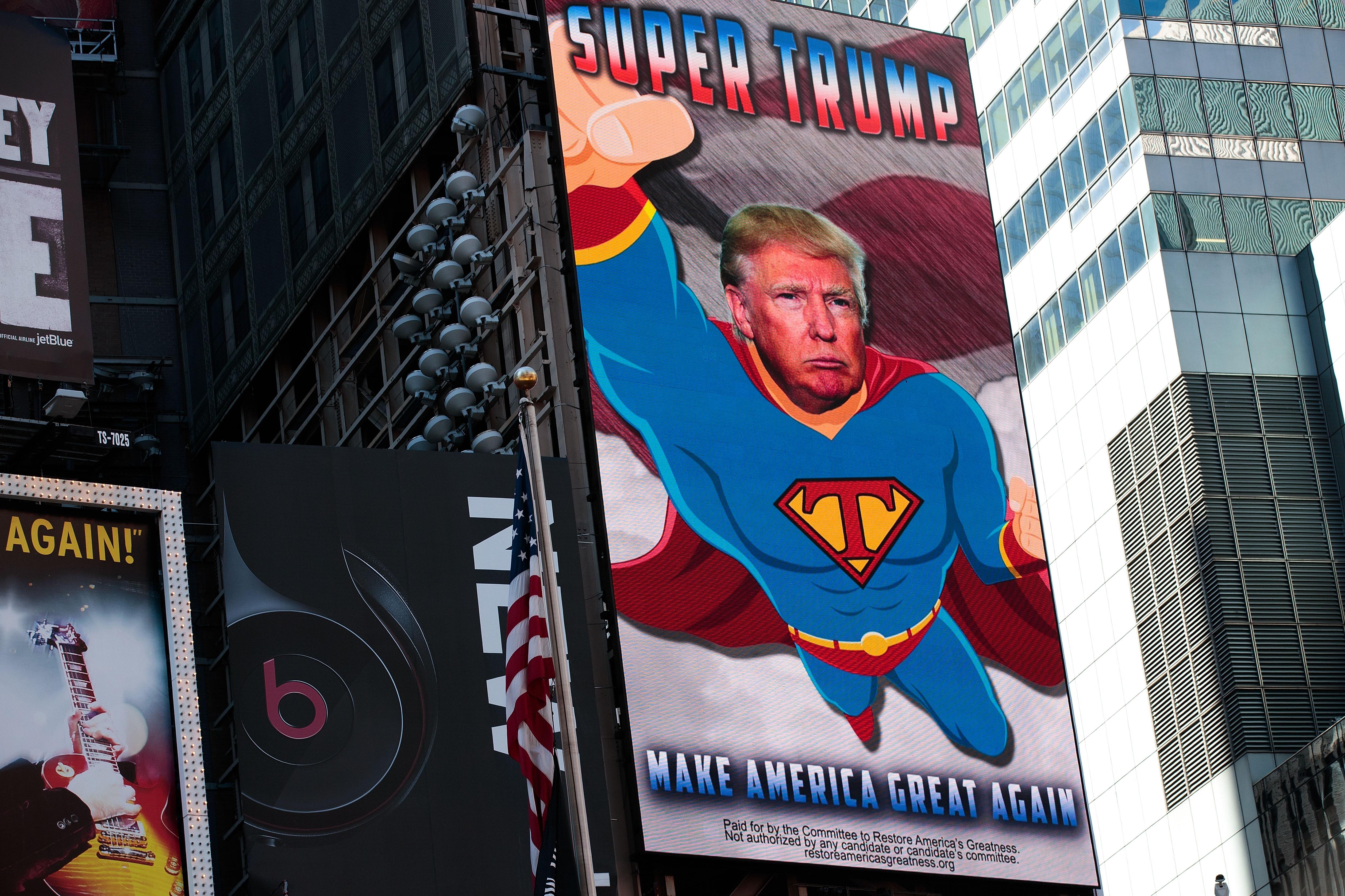 """Дигитален билборд показва Тръмп като Супермен. Слоганът на кампанията му е: """"Да направим Америка велика отново"""""""