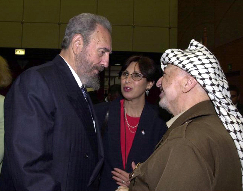 31 август 2001 г. - Фидел Кастро се среща с палестинския лидер Ясер Арафат по време на свеовна конференция срещу расизма в Дърбан, Южна Африка.