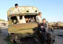 Афганистански деца играят на изоставен военен камион