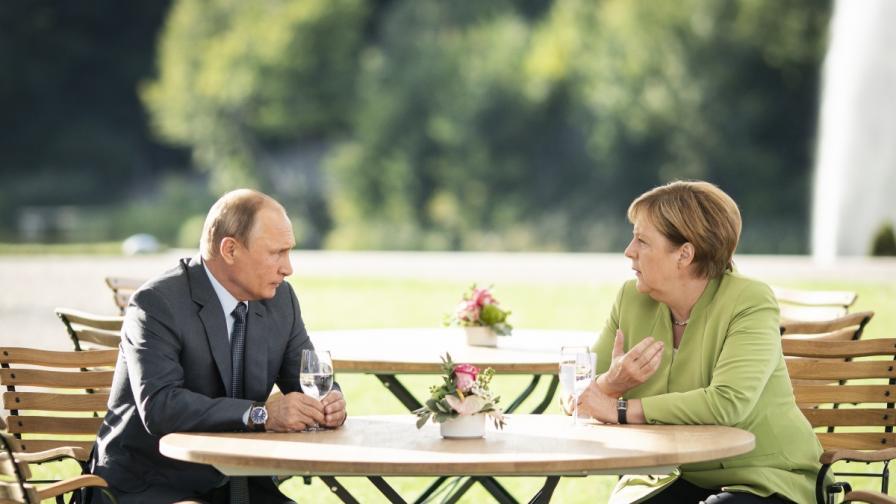 Президентът на Русия Владимир Путин и германският канцлер Ангела Меркел