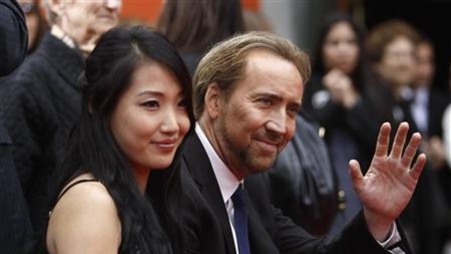 Никълъс Кейдж със съпругата си Алис (снимка от май 2010 г.)