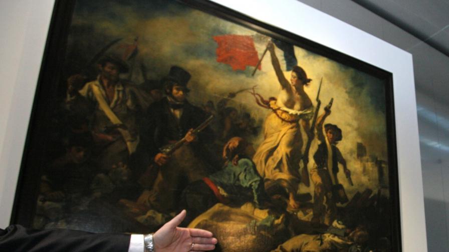 """Жена надраска картината """"Свободата води народа"""" в Лувъра"""